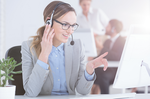 iStock-837432342_contact center lady pointing at screen_resized.png