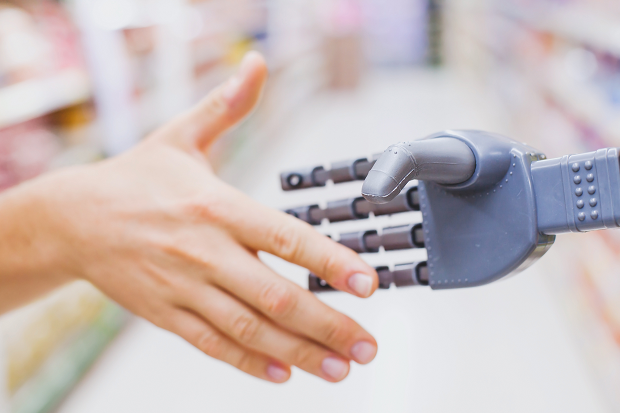 iStock-638374622_human and robot shake hands_resized.png